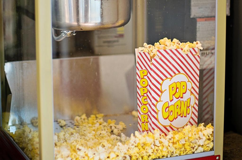Popcorn machine and bag full of popcorn